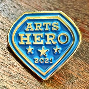 Arts District pin on wooden background